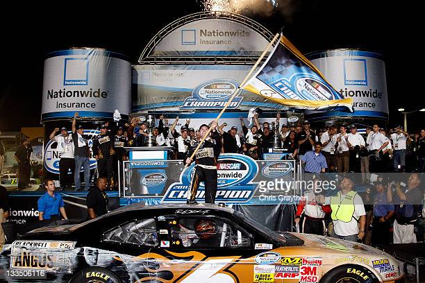 Ricky Stenhouse Jr driver of the Blackwell Angus Beef Ford celebrates in Victory Lane after winning the 2011 Series Championship after the NASCAR...