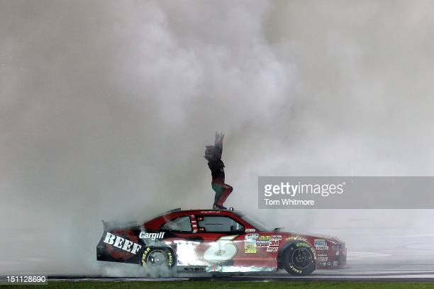 Ricky Stenhouse Jr driver of the Cargill Beef Ford celebrates after he won the NASCAR Nationwide Series NRA American Warrior 300 at Atlanta Motor...