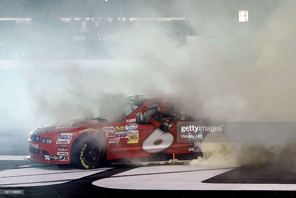 Ricky Stenhouse Jr., driver of the #6 Cargill Beef Ford, performs a burnout as he celebrates winning during the NASCAR Nationwide Series NRA American Warrior 300 at Atlanta Motor Speedway on September 1, 2012 in Hampton, Georgia.
