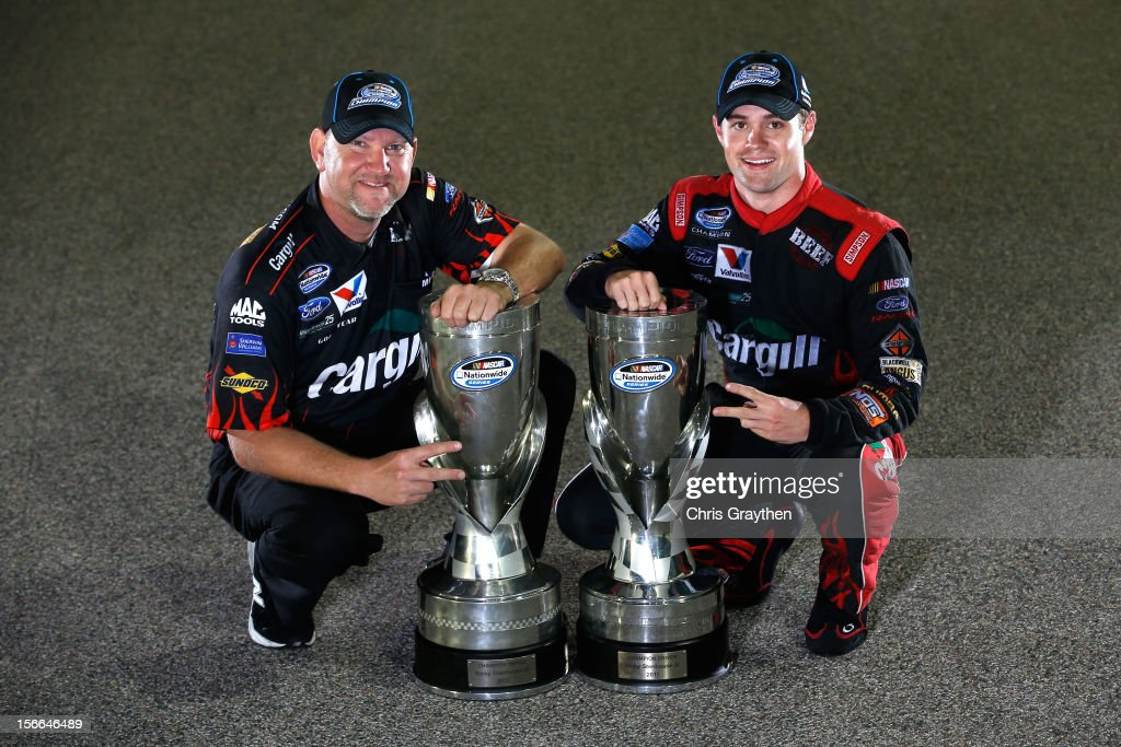 <a gi-track='captionPersonalityLinkClicked' href=/galleries/search?phrase=Ricky+Stenhouse+Jr.&family=editorial&specificpeople=5380612 ng-click='$event.stopPropagation()'>Ricky Stenhouse Jr.</a>, driver of the #6 Cargill Ford, and crew chief Mike Kelley pose on the track after winning back-to-back Nationwide series championships after competing in the NASCAR Nationwide Series Ford EcoBoost 300 at Homestead-Miami Speedway on November 17, 2012 in Homestead, Florida.