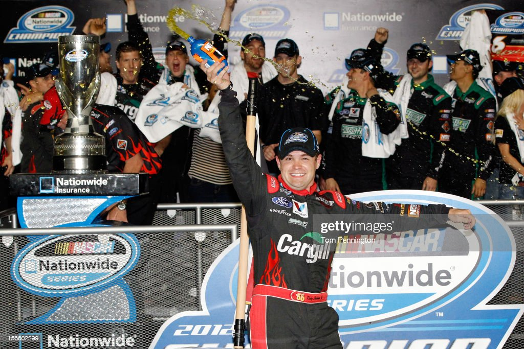 <a gi-track='captionPersonalityLinkClicked' href=/galleries/search?phrase=Ricky+Stenhouse+Jr.&family=editorial&specificpeople=5380612 ng-click='$event.stopPropagation()'>Ricky Stenhouse Jr.</a>, driver of the #6 Cargill Ford, celebrates in Champions Victory Lane after winning the series championship and finishing sixth in the NASCAR Nationwide Series Ford EcoBoost 300 at Homestead-Miami Speedway on November 17, 2012 in Homestead, Florida.
