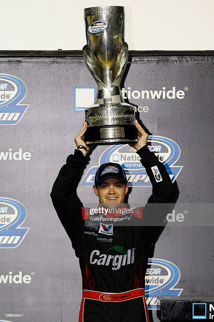 Ricky Stenhouse Jr., driver of the #6 Cargill Ford, hoist the trophy in Champions Victory Lane after winning the series championship and finishing sixth in the NASCAR Nationwide Series Ford EcoBoost 300 at Homestead-Miami Speedway on November 17, 2012 in Homestead, Florida.