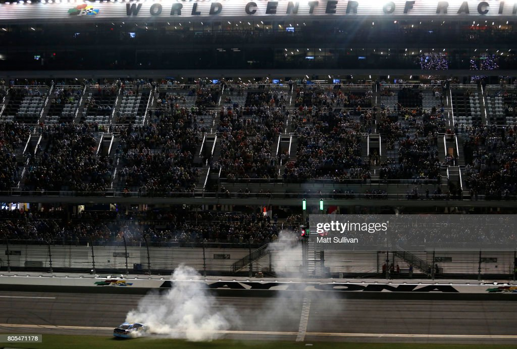 Ricky Stenhouse Jr., driver of the #17 Fifth Third Bank Ford, celebrates with a burnout after winning the Monster Energy NASCAR Cup Series 59th Annual Coke Zero 400 Powered By Coca-Cola at Daytona International Speedway on July 1, 2017 in Daytona Beach, Florida.