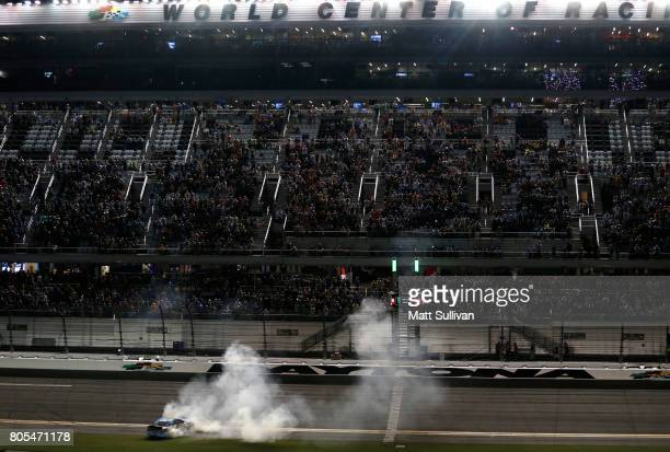 Ricky Stenhouse Jr driver of the Fifth Third Bank Ford celebrates with a burnout after winning the Monster Energy NASCAR Cup Series 59th Annual Coke...