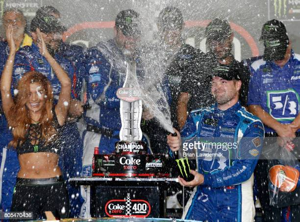 Ricky Stenhouse Jr driver of the Fifth Third Bank Ford celebrates in Victory Lane after winning the Monster Energy NASCAR Cup Series 59th Annual Coke...