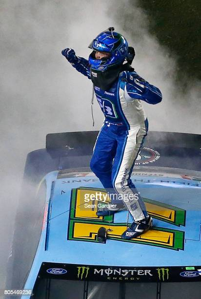 Ricky Stenhouse Jr driver of the Fifth Third Bank Ford celebrates winning the Monster Energy NASCAR Cup Series 59th Annual Coke Zero 400 Powered By...