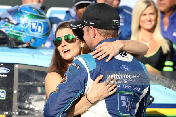 Ricky Stenhouse Jr driver of the Fifth Third Bank Ford kisses his girlfriend Danica Patrick driver of the Aspen Dental Ford in Victory Lane after...
