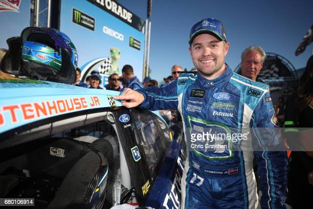 Ricky Stenhouse Jr driver of the Fifth Third Bank Ford poses with the winner's decal in Victory Lane after winning the Monster Energy NASCAR Cup...
