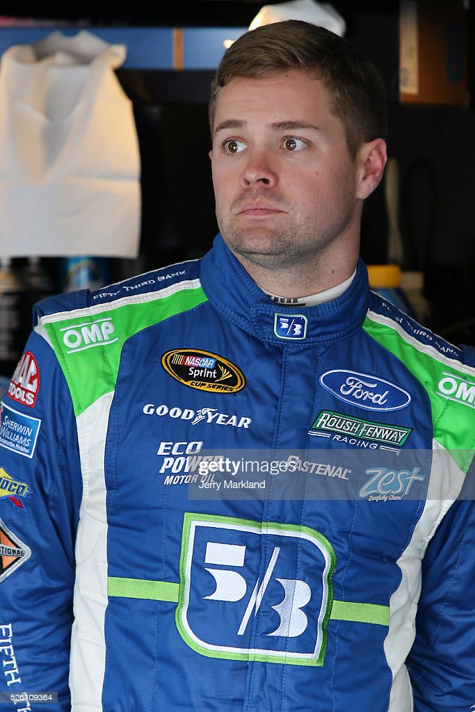 Ricky Stenhouse Jr, driver of the #17 Fifth Third Bank Ford, stands in the garage area during practice for the NASCAR Sprint Cup Series GEICO 500 at Talladega Superspeedway on April 29, 2016 in Talladega, Alabama.
