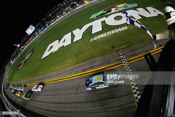 Ricky Stenhouse Jr driver of the Fifth Third Bank Ford takes the checkered flag to win the Monster Energy NASCAR Cup Series 59th Annual Coke Zero 400...