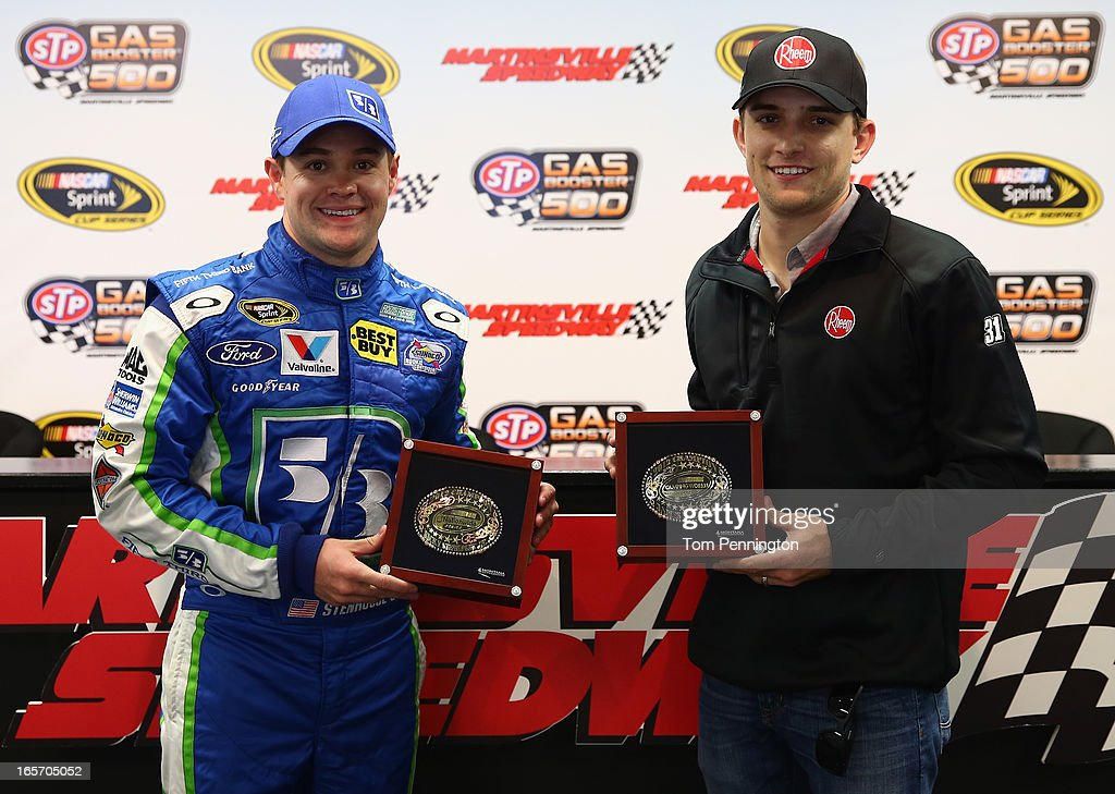 Ricky Stenhouse Jr., driver of the #17 Fifth Third Ford, and James Buescher, driver of the #31 Rheem Chevrolet, display their series championship belt buckles at Martinsville Speedway in Ridgeway, Virginia.