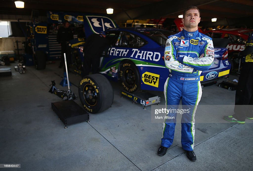 Ricky Stenhouse Jr., driver of the #17 Fifth Third Ford, stands in the garage area during practice for the NASCAR Sprint Cup Series STP Gas Booster 500 on April 6, 2013 at Martinsville Speedway in Ridgeway, Virginia.