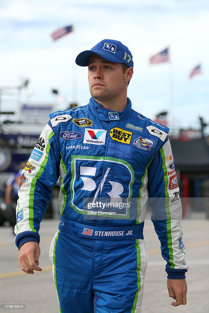 <a gi-track='captionPersonalityLinkClicked' href=/galleries/search?phrase=Ricky+Stenhouse+Jr.&family=editorial&specificpeople=5380612 ng-click='$event.stopPropagation()'>Ricky Stenhouse Jr.</a>, driver of the #17 Fifth Third Ford, walks through the garage area during practice for the NASCAR Sprint Cup Series Coke Zero 400 at Daytona International Speedway on July 4, 2013 in Daytona Beach, Florida.