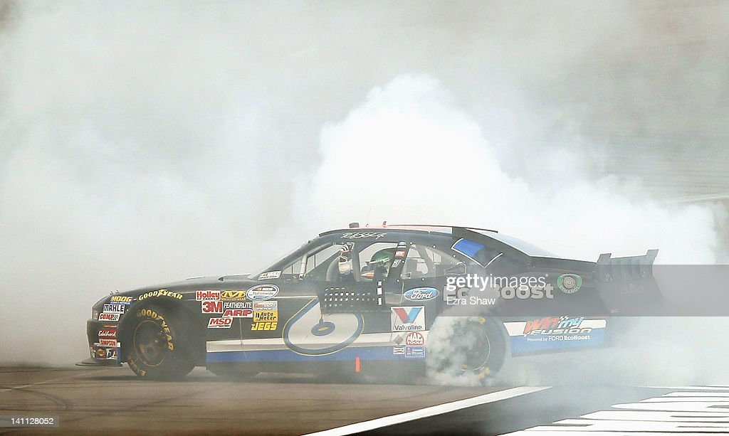 <a gi-track='captionPersonalityLinkClicked' href=/galleries/search?phrase=Ricky+Stenhouse+Jr.&family=editorial&specificpeople=5380612 ng-click='$event.stopPropagation()'>Ricky Stenhouse Jr.</a>, driver of the #6 Ford EcoBoost Ford, does a burnout after winning the NASCAR Nationwide Series Sam's Town 300 at Las Vegas Motor Speedway on March 10, 2012 in Las Vegas, Nevada.