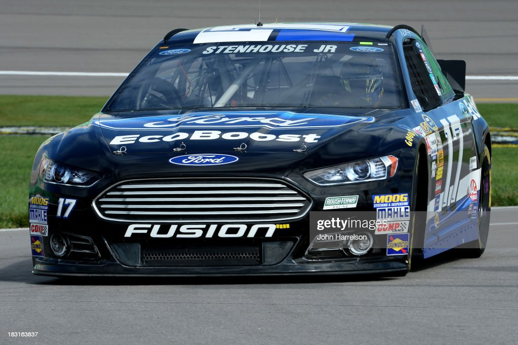 Ricky Stenhouse Jr., driver of the #17 Ford EcoBoost Ford, pulls into the garage area during practice for the NASCAR Sprint Cup Series 13th Annual Hollywood Casino 400 at Kansas Speedway on October 5, 2013 in Kansas City, Kansas.