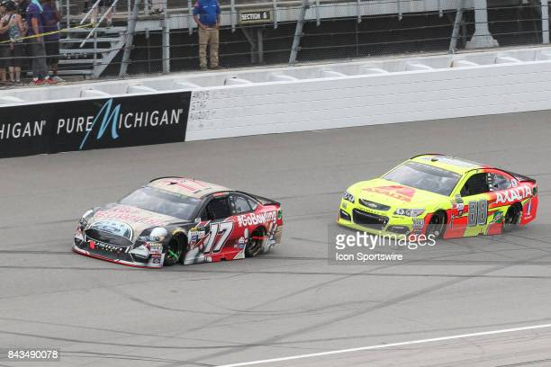Ricky Stenhouse Jr driver of the Go Bowling Ford and Dale Earnhardt Jr driver of the Axalta Chevrolet race during the Monster Energy NASCAR Cup...