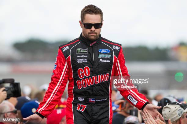 Ricky Stenhouse Jr driver of the Go Bowling Ford greets fans during the prerace ceremonies of the Monster Energy NASCAR Cup Series Pure Michigan 400...