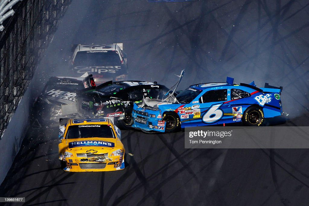 <a gi-track='captionPersonalityLinkClicked' href=/galleries/search?phrase=Ricky+Stenhouse+Jr.&family=editorial&specificpeople=5380612 ng-click='$event.stopPropagation()'>Ricky Stenhouse Jr.</a>, driver of the #6 Kellogg's Pop-Tarts Ford, spins into <a gi-track='captionPersonalityLinkClicked' href=/galleries/search?phrase=Kyle+Busch&family=editorial&specificpeople=211123 ng-click='$event.stopPropagation()'>Kyle Busch</a>, driver of the #54 Monster Energy Toyota, putting <a gi-track='captionPersonalityLinkClicked' href=/galleries/search?phrase=Kurt+Busch&family=editorial&specificpeople=201728 ng-click='$event.stopPropagation()'>Kurt Busch</a>, driver of the #1 HendrickCars.com Chevrolet, into the wall during the NASCAR Nationwide Series DRIVE4COPD 300 at Daytona International Speedway on February 25, 2012 in Daytona Beach, Florida.