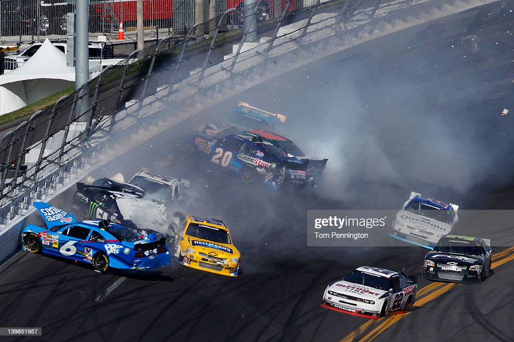 <a gi-track='captionPersonalityLinkClicked' href=/galleries/search?phrase=Ricky+Stenhouse+Jr.&family=editorial&specificpeople=5380612 ng-click='$event.stopPropagation()'>Ricky Stenhouse Jr.</a>, driver of the #6 Kellogg's Pop-Tarts Ford, spins into <a gi-track='captionPersonalityLinkClicked' href=/galleries/search?phrase=Kyle+Busch&family=editorial&specificpeople=211123 ng-click='$event.stopPropagation()'>Kyle Busch</a>, driver of the #54 Monster Energy Toyota, putting <a gi-track='captionPersonalityLinkClicked' href=/galleries/search?phrase=Kurt+Busch&family=editorial&specificpeople=201728 ng-click='$event.stopPropagation()'>Kurt Busch</a>, driver of the #1 HendrickCars.com Chevrolet, into the wall while <a gi-track='captionPersonalityLinkClicked' href=/galleries/search?phrase=Joey+Logano&family=editorial&specificpeople=4510426 ng-click='$event.stopPropagation()'>Joey Logano</a>, driver of the #20 GameStop Toyota, spins into <a gi-track='captionPersonalityLinkClicked' href=/galleries/search?phrase=Trevor+Bayne&family=editorial&specificpeople=5533943 ng-click='$event.stopPropagation()'>Trevor Bayne</a>, driver of the #60 Roush Fenway Racing Ford, putting <a gi-track='captionPersonalityLinkClicked' href=/galleries/search?phrase=Tony+Stewart+-+Race+Car+Driver&family=editorial&specificpeople=201686 ng-click='$event.stopPropagation()'>Tony Stewart</a>, driver of the #33 Oreo/Ritz Chevrolet, into the wall during a last lap incident during the NASCAR Nationwide Series DRIVE4COPD 300 at Daytona International Speedway on February 25, 2012 in Daytona Beach, Florida.