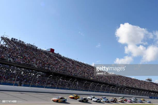 Ricky Stenhouse Jr driver of the SunnyD Ford leads the field during the Monster Energy NASCAR Cup Series Alabama 500 at Talladega Superspeedway on...