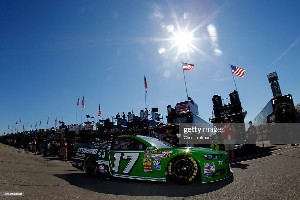Ricky Stenhouse Jr. drives the #17 EcoPower Oil Ford through the garage area during practice for the NASCAR Sprint Cup Series Quicken Loans 400 at Michigan International Speedway on June 14, 2014 in Brooklyn, Michigan.