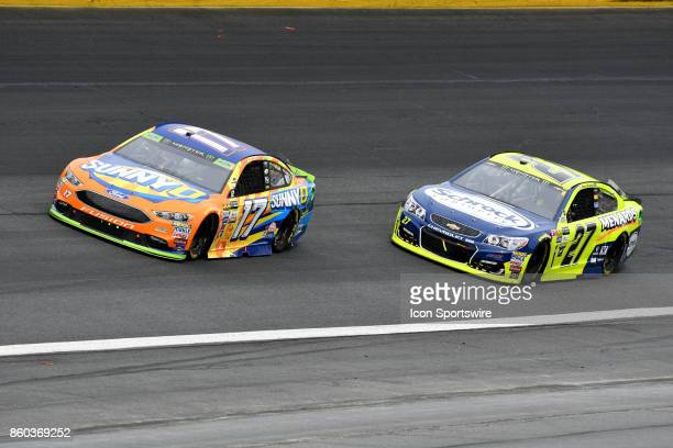 Ricky Stenhouse Jr Roush Fenway Racing Ford Fusion and Paul Menard Richard Childress Racing Chevrolet SS through turn four during the Monster Energy...