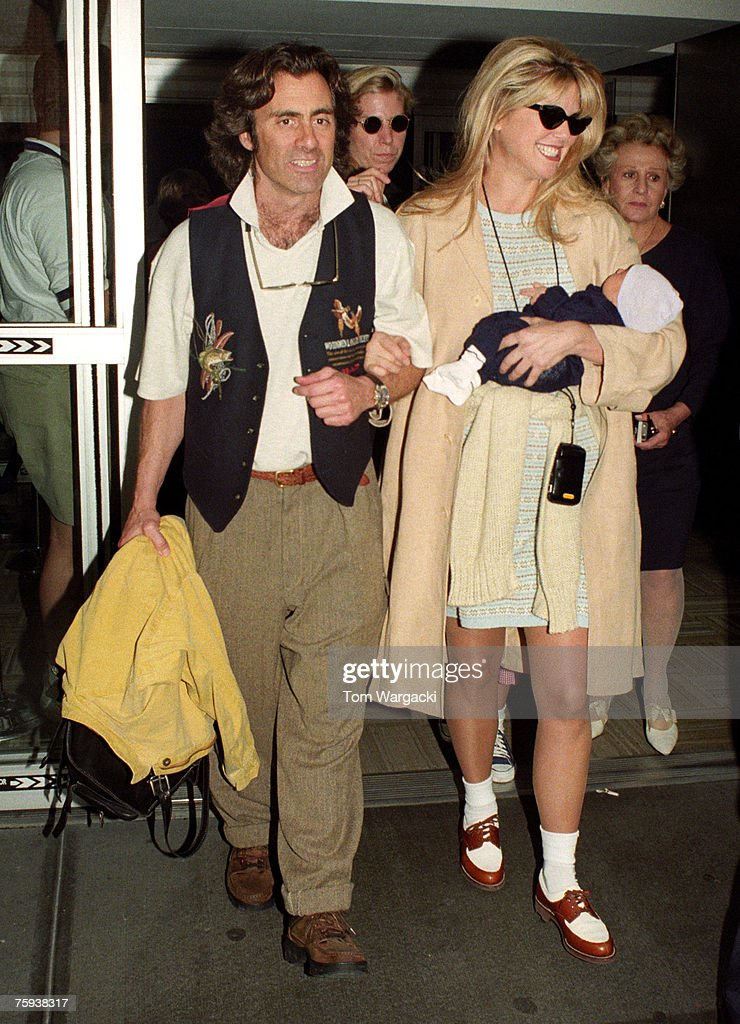 Ricky Taubman (L), son (C) and Christie Brinkley leave Lennox Hill Hospial after the birth of their son on June 05, 1995 in New York City.