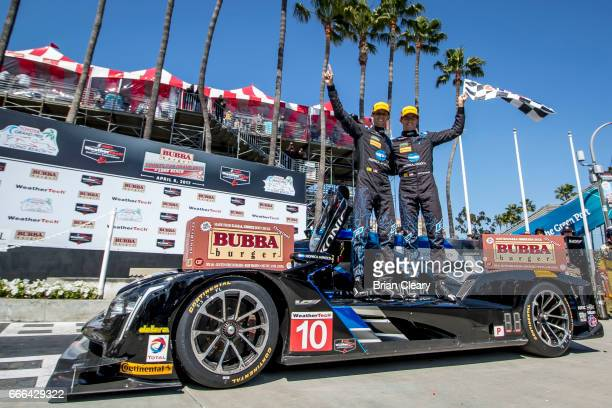 Ricky Taylor and Jordan Taylor celebrate in victory lane after winning the Grand Prix at Long Beach IMSA WaetherTech series race on April 8 2017 in...