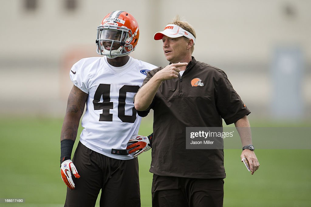 Ricky Tunstall #40 talks with Special Teams Coordinator Chris Tabor of the Cleveland Browns during rookie camp at the Cleveland Browns Training facility on May 10, 2013 in Cleveland, Ohio.
