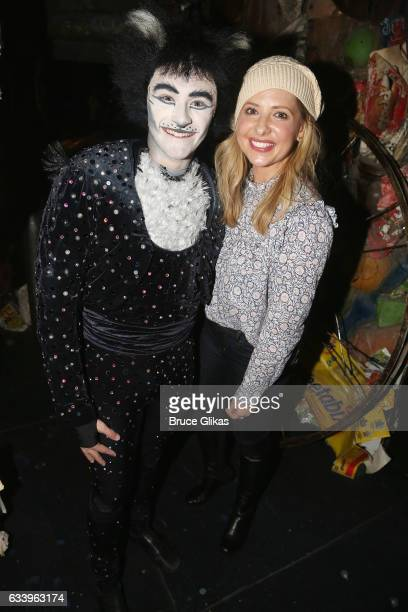 Ricky Ubeda as 'Mr Mistoffeles' and Sarah Michelle Gellar pose backstage at the hit musical 'Cats' on Broadway at The Neil Simon Theatre on February...