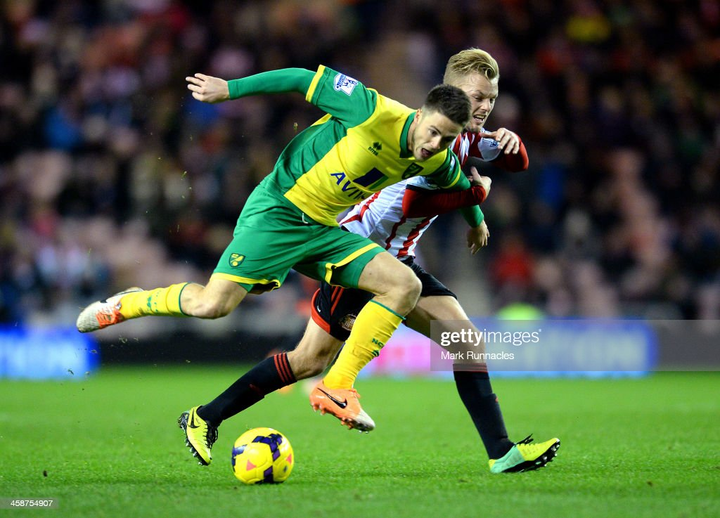 Ricky Van Wolfswinkel of Norwich City challenges <a gi-track='captionPersonalityLinkClicked' href=/galleries/search?phrase=Sebastian+Larsson&family=editorial&specificpeople=719331 ng-click='$event.stopPropagation()'>Sebastian Larsson</a> of Sunderland during the Barclays Premier League match between Sunderland and Norwich City at the Stadium of Light on December 21, 2013 in Sunderland, England.