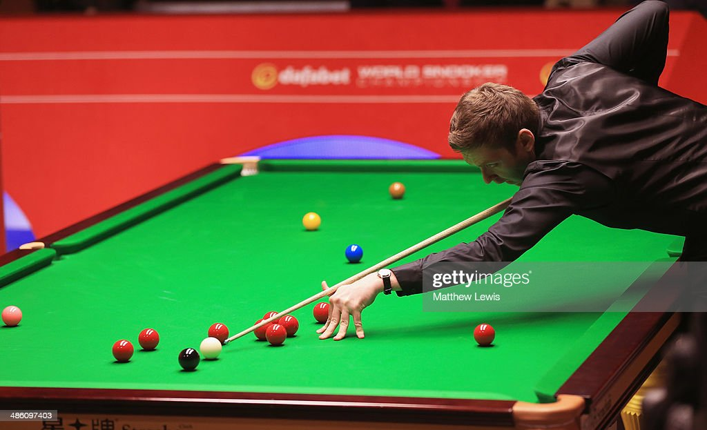 Ricky Walden of England in action agsint Kyren Wilson of England during day four of the The Dafabet World Snooker Championship at Crucible Theatre on April 21, 2014 in Sheffield, England.