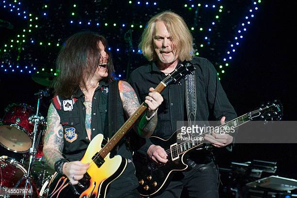 Ricky Warwick and Scott Gorham of Thin Lizzy perform on stage supporting Guns n' Roses at O2 Arena on May 31 2012 in London United Kingdom