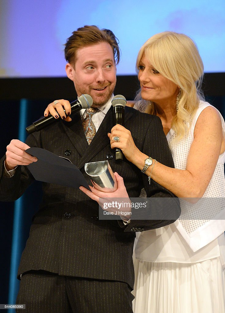 Ricky Wilson and Gaby Roslin on stage during the Nordoff Robbins O2 Silver Clef Awards on July 1, 2016 in London, United Kingdom.