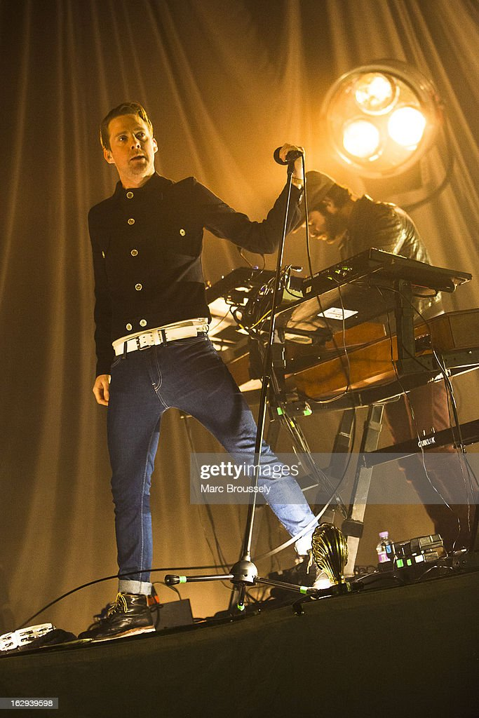 Ricky Wilson and Nick 'Peanut' Baines of Kaiser Chiefs perform on stage at Hammersmith Apollo on March 1, 2013 in London, England.