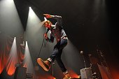 Ricky Wilson of the Kaiser Chiefs perform on stage at Leeds Arena on September 13 2013 in Leeds England