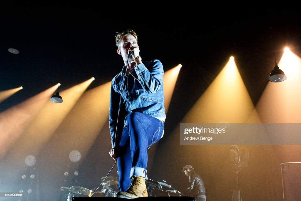 Ricky Wilson of the Kaiser Chiefs performs at First Direct Arena on September 13 2013 in Leeds England