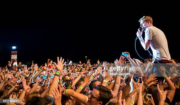Ricky Wilson of the Kaiser Chiefs performs on stage during their headline set at MTV Crashes Plymouth at Plymouth Hoe on July 15 2014 in Plymouth...