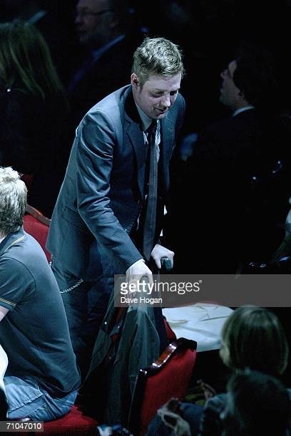 Ricky Wilson of the Kaiser Chiefs stands on crutches as he goes to collect his award for the Album Award category at the 51st Ivor Novello Awards at...