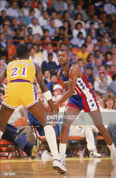 Ricky Wilson of the New Jersey Nets dribbles the ball as Michael Cooper of the Los Angeles Lakers defends during the NBA game at the Great Western...