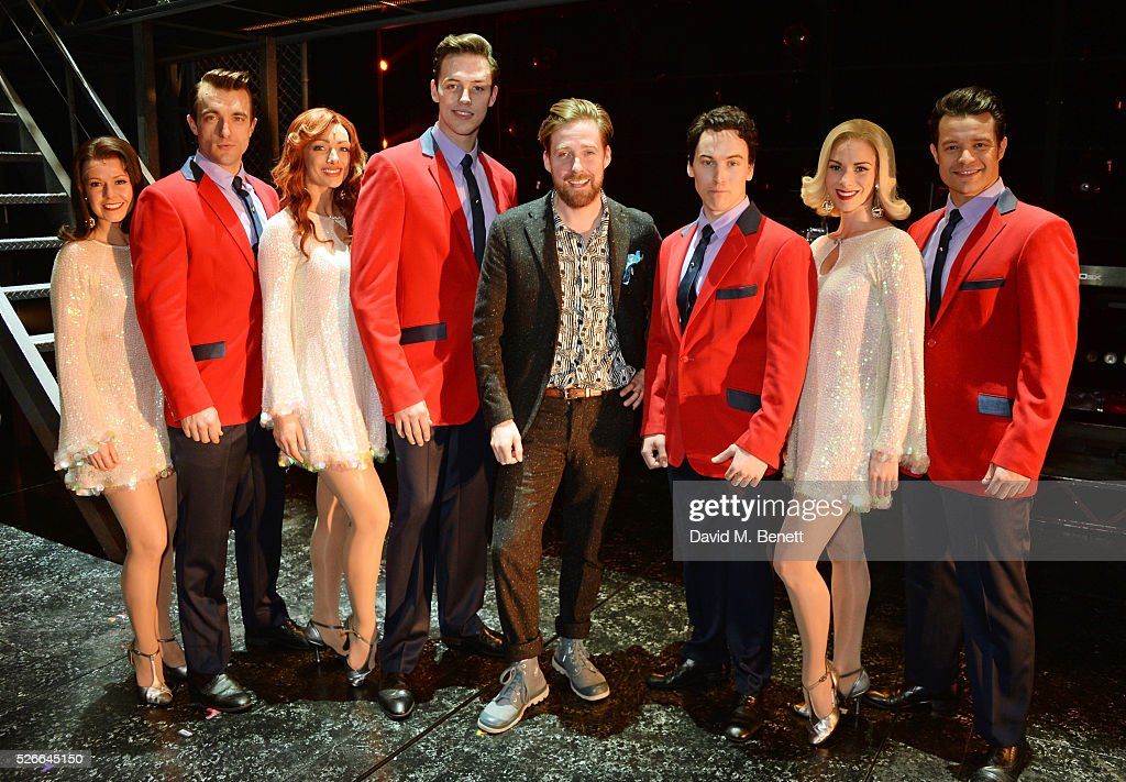 Ricky Wilson (C) poses backstage with cast members (L-R) Lucinda Gill, Matt Hunt, Nicky Griffiths, Declan Egan, Matt Corner, Helen Ternent and Simon Bailey following a performance of 'Jersey Boys' at The Piccadilly Theatre on April 30, 2016 in London, England.