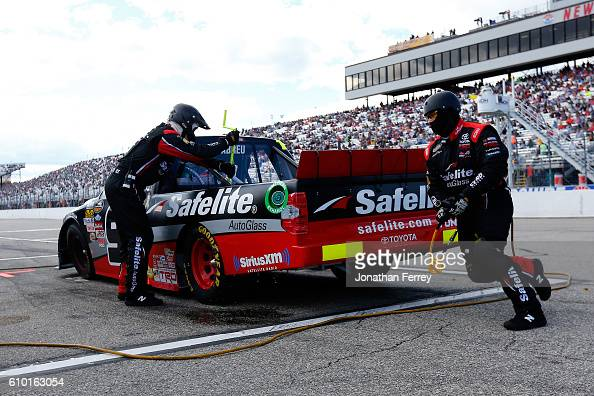 Rico Abreu driver of the Safelite Auto Glass/Curb Records Toyota pits during the NASCAR Camping World Truck Series UNOH 175 at New Hampshire Motor...