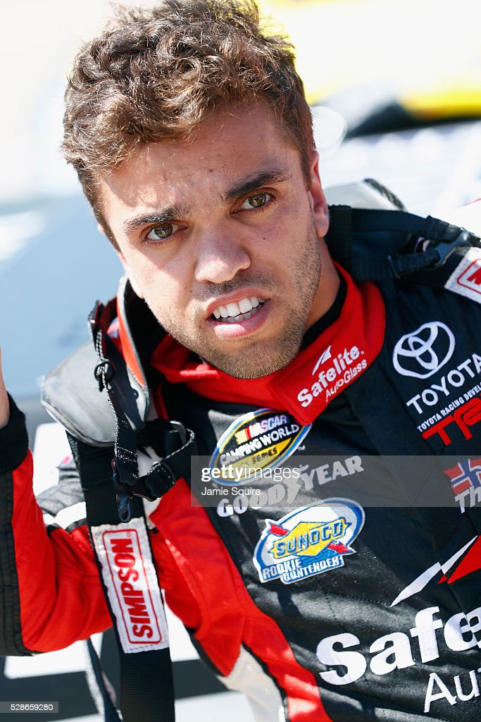 Rico Abreu, driver of the (98) Safelite Toyota, looks on during qualifying for the NASCAR Camping World Truck Series Toyota Tundra 250 at Kansas Speedway on May 6, 2016 in Kansas City, Kansas.