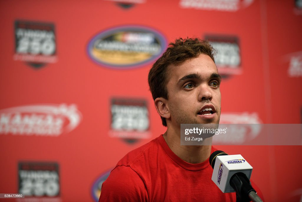 Rico Abreu, driver of the #98 Safelite Toyota, talks to the media prior to a practice sessions for the Toyota Tundra 250 at Kansas Speedway on May 5, 2016 in Kansas City, Kansas.