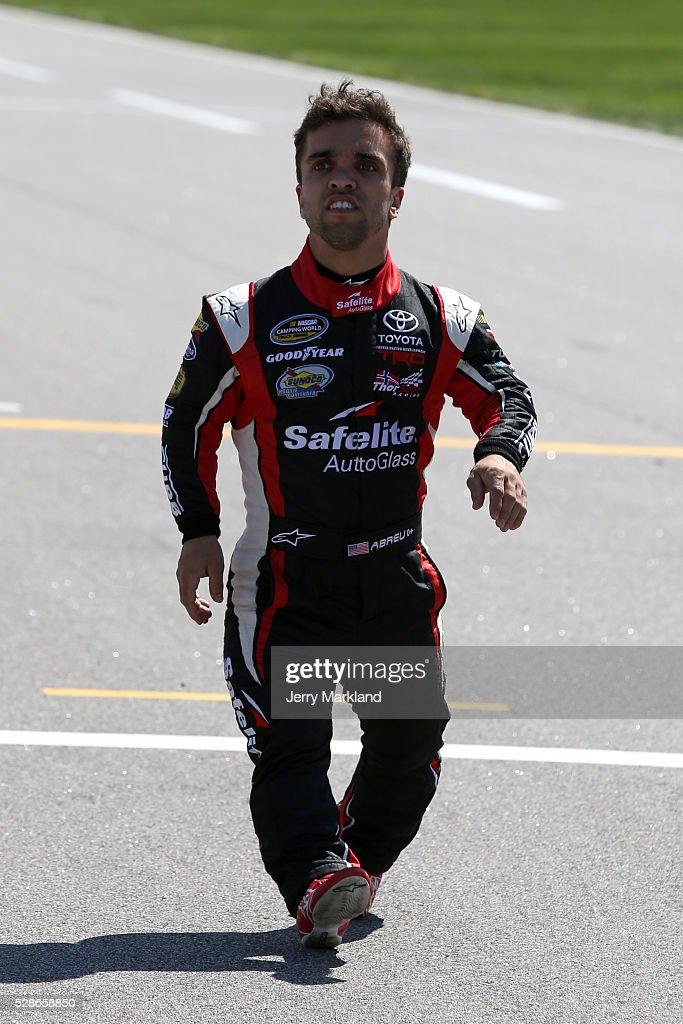 Rico Abreu, driver of the (98) Safelite Toyota, walks to his truck during qualifying for the NASCAR Camping World Truck Series Toyota Tundra 250 at Kansas Speedway on May 6, 2016 in Kansas City, Kansas.