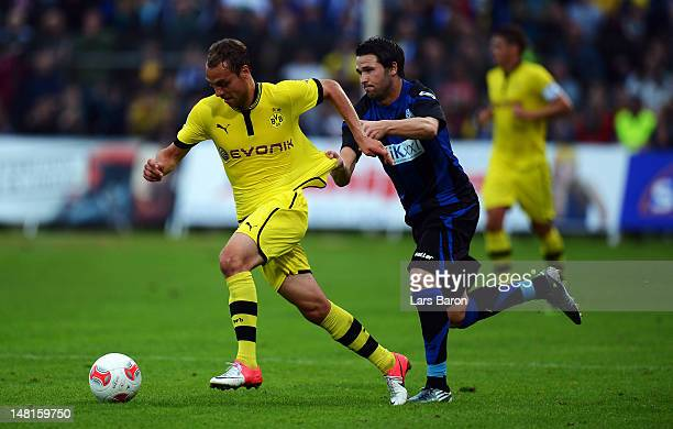 Rico Benatelli of Dortmund is challenged by Jens Robben of Meppen during a friendly match between SV Meppen and Borussia Dortmund at MEPArena on July...