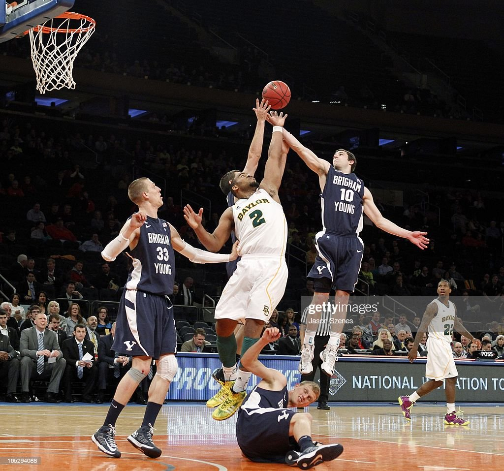 Rico Gathers #2 of the Baylor Bears jumps for a rebound against Matt Carlino #10 of the Brigham Young Cougars in the first half during the 2013 NIT Championship - Semifinals at the Madison Square Garden on April 2, 2013 in New York City.