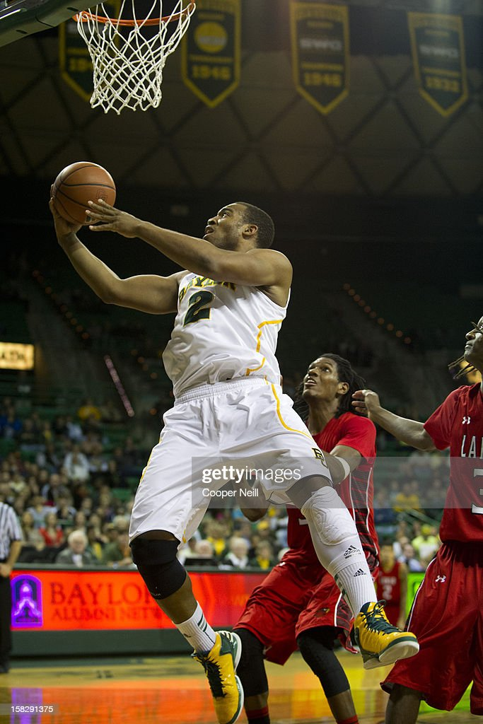 Rico Gathers #2 of the Baylor University Bears drives to the basket against the Lamar Cardinals on December 12, 2012 at the Ferrell Center in Waco, Texas.