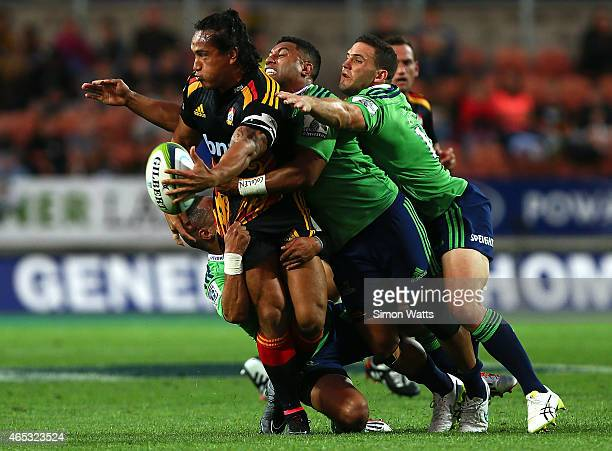Rico Gear of the Chiefs looks to offload during the round four Super Rugby match between the Chiefs and the Highlanders at Waikato Stadium on March 6...