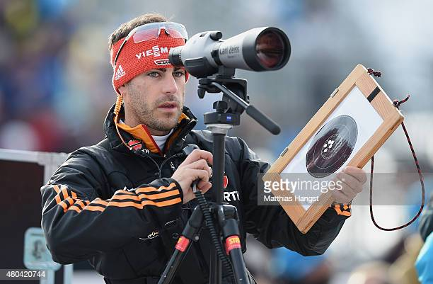 Rico Gross coach of the german biathlon team looks on prior to the women 4 x 6 km relay event in the IBU Biathlon World Cup on December 13 2014 in...